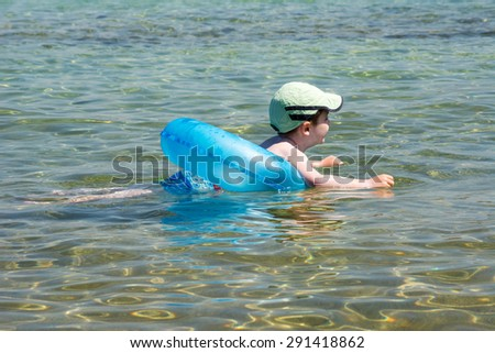 Little boy swimming with  - stock photo