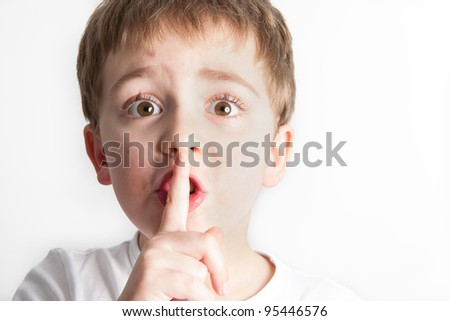 Little boy telling you to make silence - stock photo