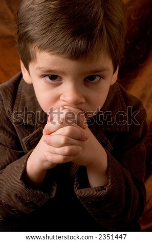 Little boy thinking - stock photo