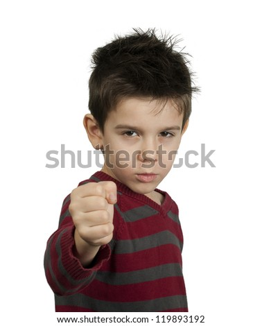 Little boy threatens with a fist to fight. White isolated - stock photo