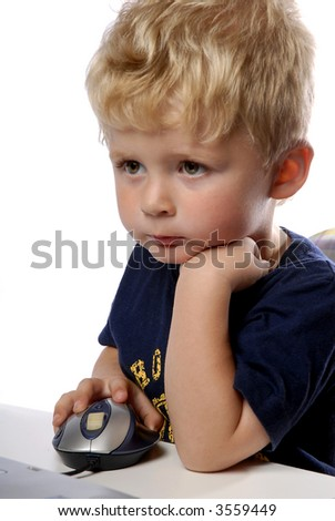 little boy using a mouse on white background - stock photo