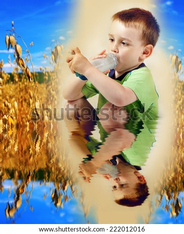 Little boy using inhaler for asthma with allergies ripe field and with reflection on water - stock photo