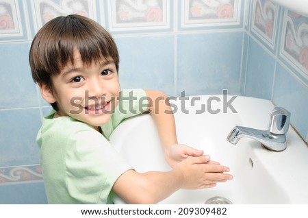 Little boy waiting for washing hand - stock photo