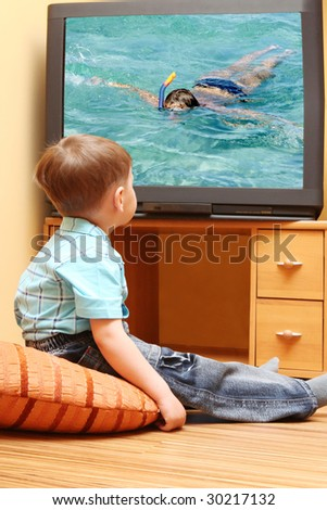 "Little boy watching cinema on TV. TV screen -  photo of the author "" Diving"""