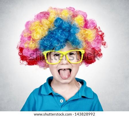 Little boy wearing clown wig and mocks - stock photo