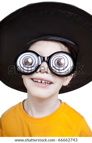 little boy wearing funny magic hat and silly glasses - stock photo