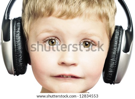 Little boy wearing headphones - stock photo