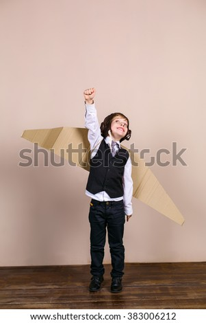 Little boy wearing school uniform and pilot hat. Boy is happy and smiling - stock photo