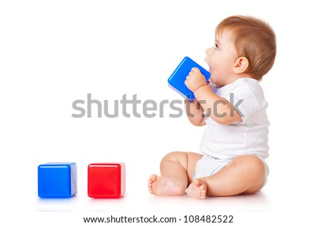 Little boy with a blue toy blocks, isolated on white - stock photo
