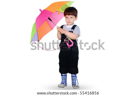 little boy with a color umbrella. On a white background. - stock photo