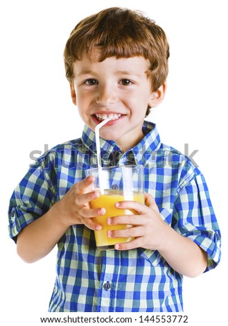 Little boy with a glass of juice isolated on white./ Child with plaid shirt drinking a fresh orange juice. - stock photo