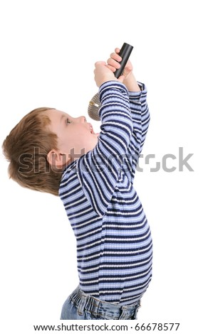 Little boy with a microphone sings over white - stock photo