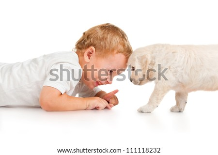 Little boy with a puppy