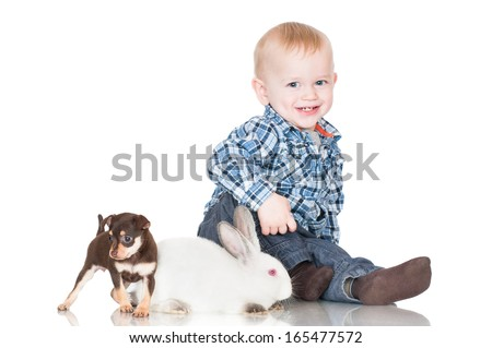 little boy with a puppy and a rabbit