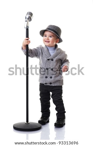 Little boy with a retro microphone - stock photo