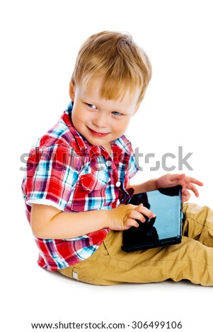 Little boy with a Tablet PC sitting on the floor - stock photo