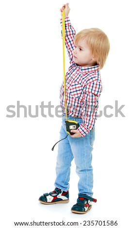 little boy with a tape measure.Childhood education development in the Montessori school concept. Isolated on white background. - stock photo