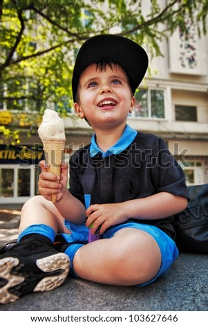 Little boy with an ice cream - stock photo