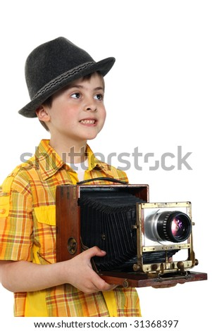 Little boy with an old camera on a white background. (See more people in my portfolio).   - stock photo