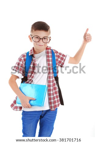 Little boy with back pack and glasses raising finger, isolated on white