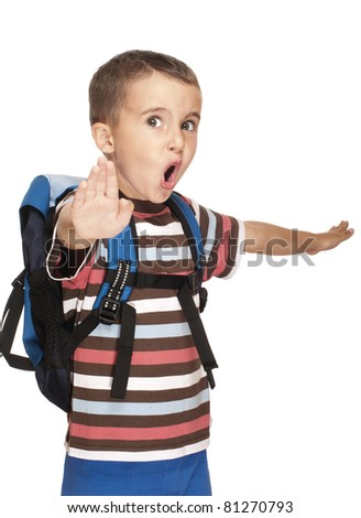 Little boy with backpack pretends kung-fu isolated on white - stock photo