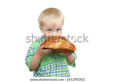 Little boy with bagel, isolated on white - stock photo