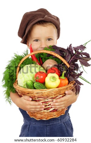 Little boy with basket of vegetables, isolated on white - stock photo