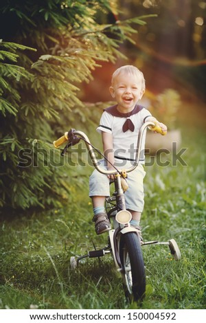 little boy with bicycle - stock photo