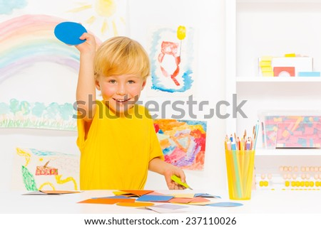 Little boy with blond hair and cardboard circle