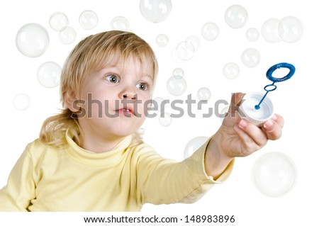 little boy with bubbles on white background