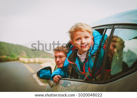 little boy with dad travel by car in nature