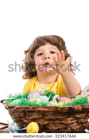 Little boy with Easter basket gesturing isolated on white background - stock photo