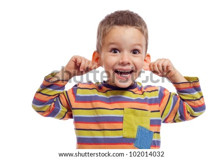 Little boy with funny face, pulling himself on the ears, isolated on white - stock photo