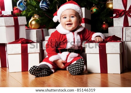 Little boy with gift boxes. - stock photo