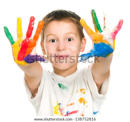 little boy with hands in paint isolated on white background - stock photo