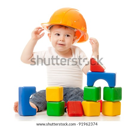 little boy with hard hat and building blocks - stock photo