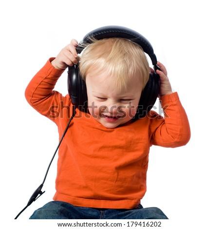 Little boy with headphones  - stock photo
