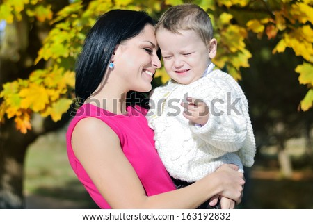little boy with his mother in autumn park