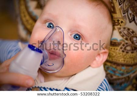 Little boy with inhalation mask - stock photo