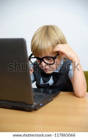 little boy with laptop - stock photo