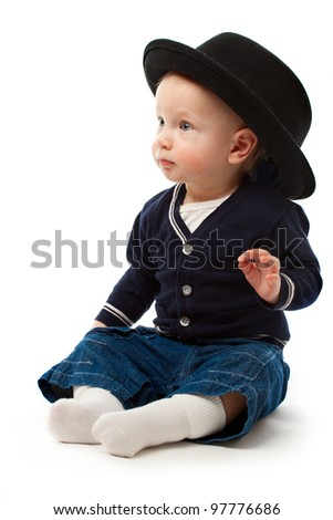 Little boy with large black hat - stock photo
