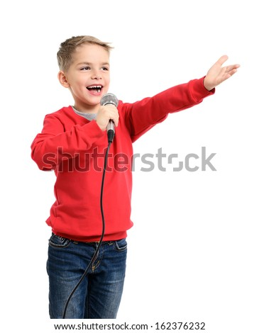 Little boy with microphone sings a song. Isolated on a white background - stock photo