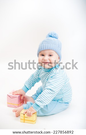 little boy with new years presents - stock photo