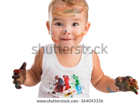 little boy  with painted face and hands  - stock photo