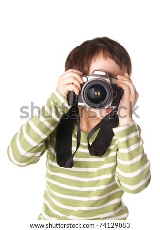 Little boy with photo camera isolated on white background - stock photo