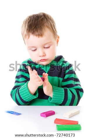 Little boy with plasticine - stock photo