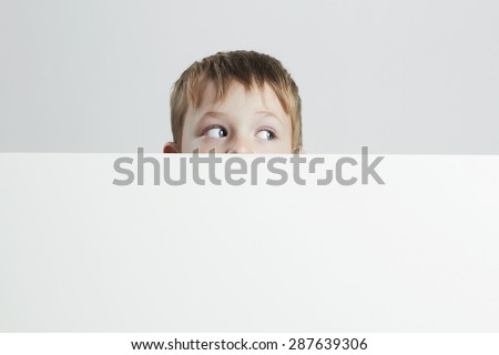 little boy with rolling eyes is happy and excited.funny child.your text here - stock photo