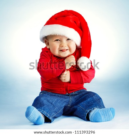 little boy with Santa costume - stock photo