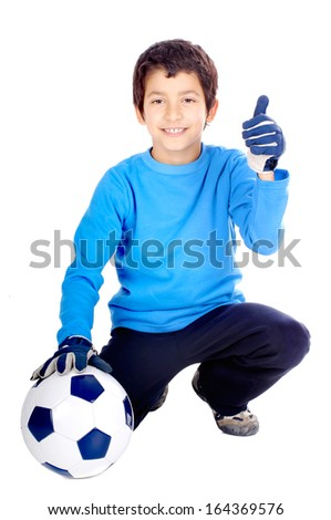 little boy with soccer ball isolated in white - stock photo