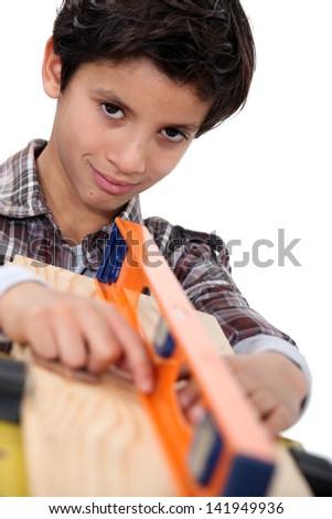 little boy with spirit level - stock photo